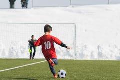 Kids soccer football tournament - children players match on socc Stock Images