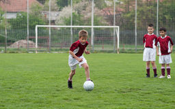 Kids soccer game Royalty Free Stock Images