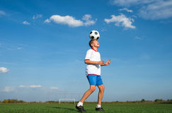Kids soccer. Soccer Player Head Shooting a Ball stock photo