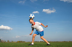 Kids soccer. Soccer Player Head Shooting a Ball stock images