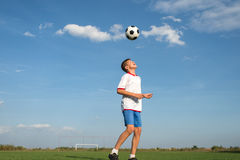 Kids soccer. Soccer Player Head Shooting a Ball stock photos