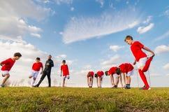 Kids soccer team. Exercise on soccer field Stock Photos