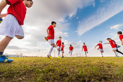 Kids soccer team. Exercise on soccer field royalty free stock photo
