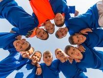 Kids soccer team. In huddle Stock Photo