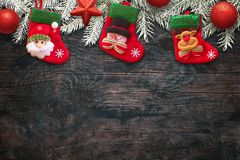 Kids sock on wooden table waiting for Santa Claus gifts. Free space for text bottom on wooden board. Top view Stock Photo