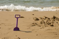 Kids spade on the sea beach Stock Photography