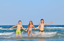 Kids splashing and playing Stock Images