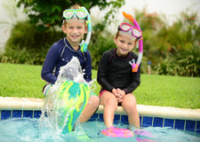 Kids splashing in pool Stock Photo