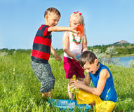 Kids splashing water Royalty Free Stock Photo