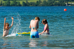 Kids splashing in the water Royalty Free Stock Images