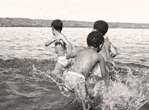 Kids splashing water at the beach Royalty Free Stock Photo