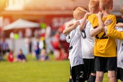 Youth Football Academy Background with Copy Space. Kids Sport Team Gathering. Children Play Sports. Boys in Sportswear Jersey Uniforms Having Shout Team. Youth stock photos
