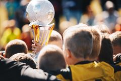 Kids Sport Team with Trophy. Kids Celebrating Football Championship. Happy Young Soccer Players Holding Golden Cup. Football Team Winning Youth Soccer stock photos
