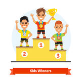 Kids sport winners standing on podium Royalty Free Stock Image