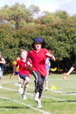 Kids in sports race Royalty Free Stock Photos