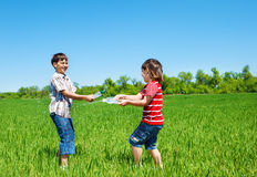 Kids spraying water Royalty Free Stock Images