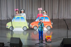 Kids on stage with toy cars. MOSCOW - APR 4: Kids on stage with toy cars on District Competition Crystal droplet on April 7, 2012 in Moscow, Russia Stock Photos