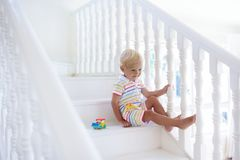 Kids on stairs. Child moving into new home. Royalty Free Stock Images