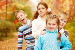 Kids stand one behind another Royalty Free Stock Photography