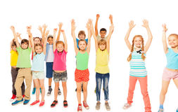 Kids stand together boys and girls rise hands Stock Photo