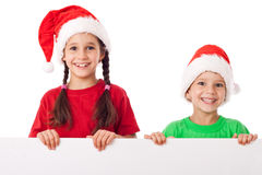 Kids standing with empty banner Royalty Free Stock Photography