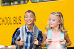 Kids standing in front of school bus Royalty Free Stock Photography
