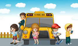 Kids standing outside school bus Stock Photography