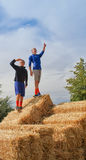 Kids standing on top of hay bales Stock Photography