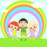 Kids standing under a rainbow Royalty Free Stock Photos
