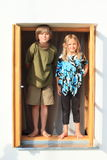 Kids standing on the window Stock Images