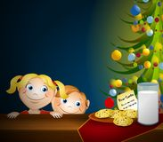 Kids Stealing Santa Cookies. An illustration featuring a couple of kids staring at Santa's cookies and milk Royalty Free Stock Images