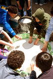 Kids Stick Hands In Tub Of Goo At Science Fair Stock Photos