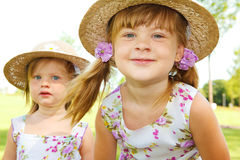 Kids in straw hats Stock Image