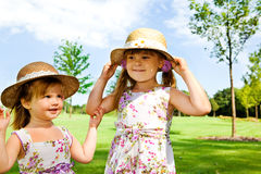 Kids in straw hats Royalty Free Stock Photos