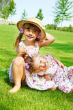 Kids in straw hats Royalty Free Stock Images