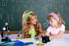Kids students in classroom helping each other Royalty Free Stock Photos