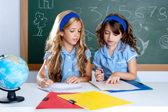 Free Kids Students In Classroom Helping Each Other Royalty Free Stock Photo - 20585475