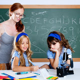 Kids students with nerd teacher woman at school Royalty Free Stock Photo