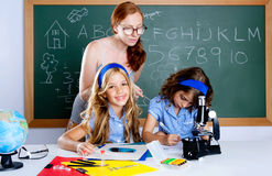 Kids students with nerd teacher woman at school Royalty Free Stock Photography