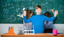 Kids study biology and chemistry in school. School education. Own research. Explore biological molecules. Future royalty free stock photography