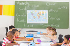 Kids studying in classroom Stock Photo