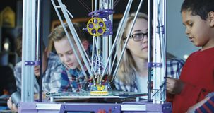 Kids studying process of 3d printing stock footage