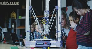 Kids studying process of 3d printing stock video