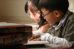 Kids studying together. Asian kids in school day stock photo