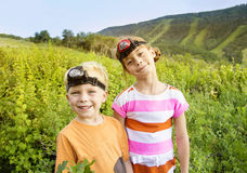 Kids Summer Adventure. Two cute kids going on an exploring adventure on a summer vacation Stock Image
