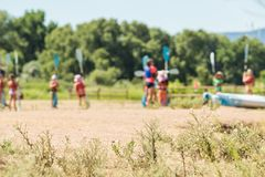 Kids summer camp. Summer kids advanture camp preparing for canoeing royalty free stock image
