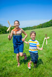 Kids in summer day holds windmill Stock Image