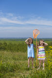 Kids summer in the meadow with orange net Royalty Free Stock Photo