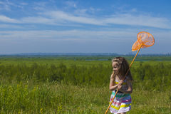 Kids summer in the meadow with orange net Stock Images