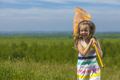Kids summer in the meadow with orange net Royalty Free Stock Image